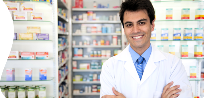 male pharmacist smiling at the camera